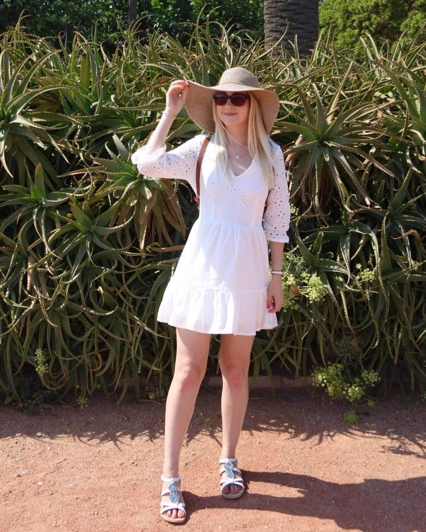white summer embroidered dress and floppy summer hat