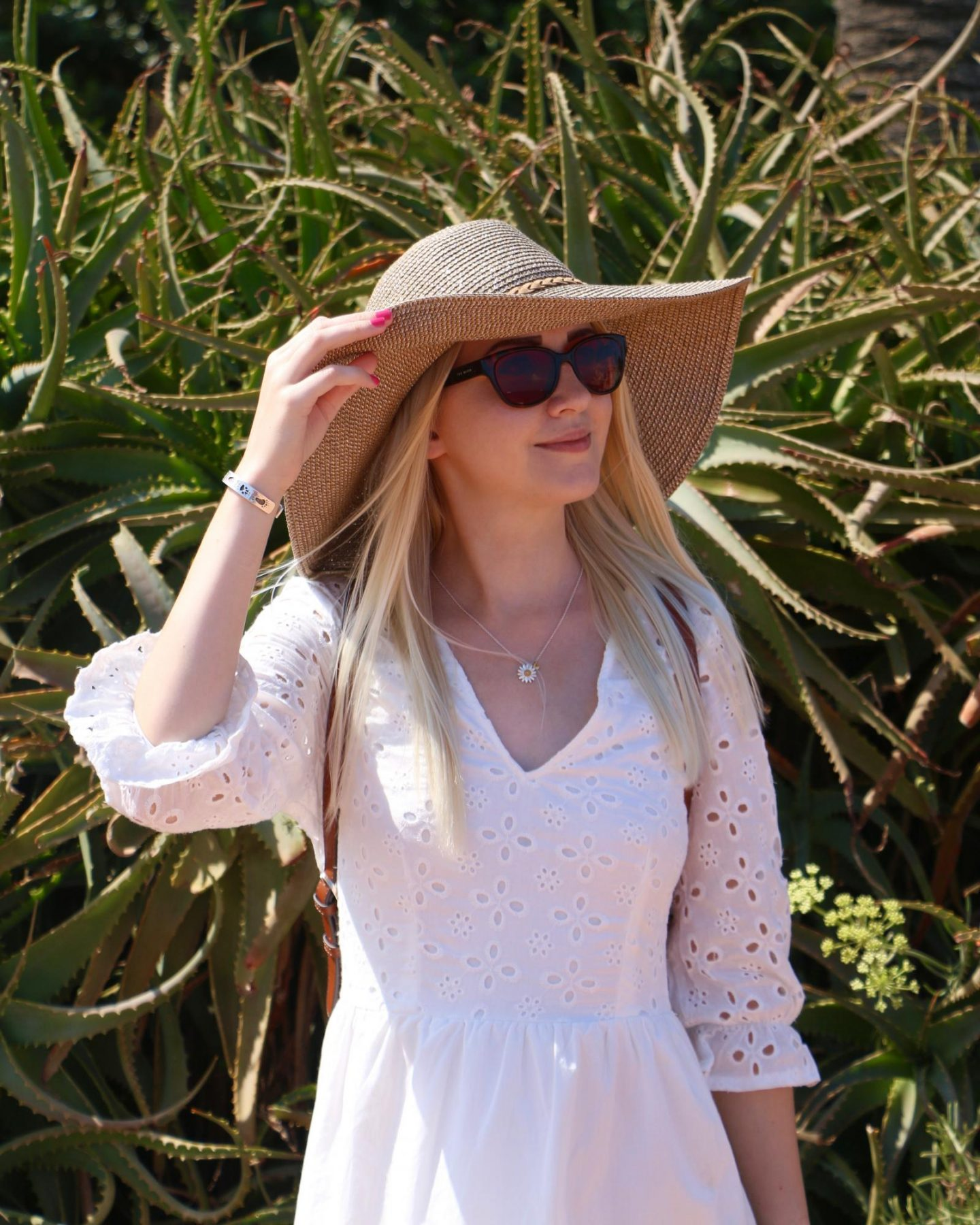 white summer embroidered dress and floppy summer hat in antibes